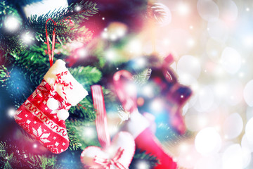 Decorated Christmas tree on blurred, sparkling and fairy background