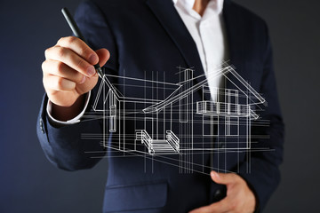Real estate offer. Businessman drawing a model of the house
