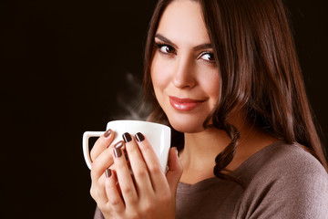 Portrait of smiling pretty woman with cup of coffee