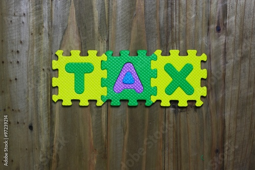 Puzzle Block Letter With Word Tax On Wood Background