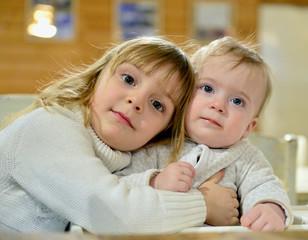 Portrait of two cute little sisters.