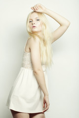 young fashion blond woman in white dress
