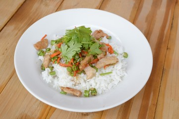 pork and vegetable fried on hot rice - Thailand healthy food