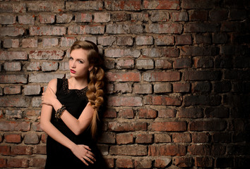 young woman on brick wall background