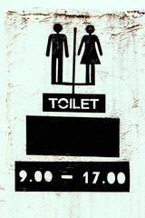 Toilet sign on cement texture