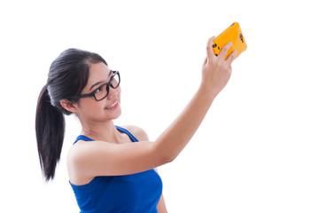 Beautiful smiling young woman taking selfie picture with her smartphone.
