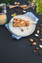 Piece of traditional scottish Dundee cake and its ingredients. Selective focus