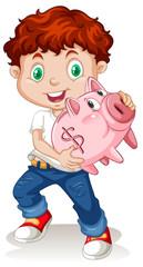 Little boy holding piggy bank
