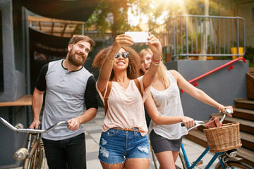 Young woman with friends taking selfie