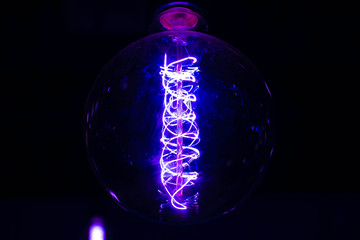 wire of light bulb in dark room