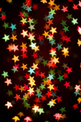 Blurring lights bokeh background of colorful stars