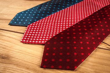 Fathers day composition of three ties hang on wooden wall backround