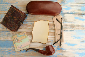 Smoking pipe, eyeglasses case, eyeglasses, money and box - copy space