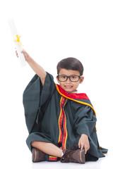 Happy boy in graduation suit.