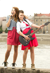 Two girls having fun with her instruments