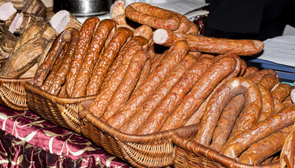 Various types of sausages in baskets