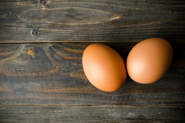 Fresh eggs on wooden background (food ingredient)