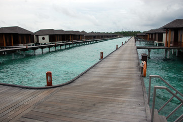 Timber pier and bungalow at Maldives