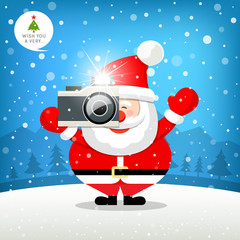 Merry christmas Santa claus hand holding photo camera on snow