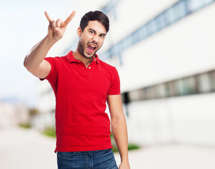 chinese man doing a rock gesture