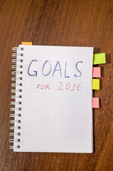 goals of year 2016 write on notebook on wooden background