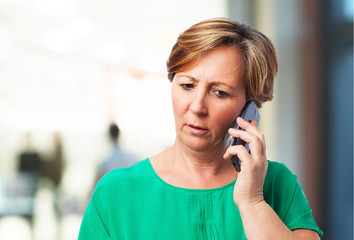 portrait of a worried mature woman talking on telephone