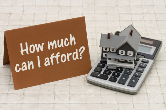 Home Mortgage Affordability, A gray house, brown card and calcul