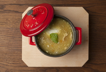 chicken soup in a red bowl