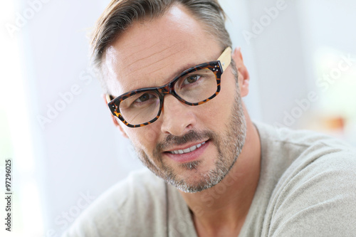 portrait of handsome 40 year old man with eyeglasses stock photo and royalty free images on. Black Bedroom Furniture Sets. Home Design Ideas