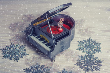 Music box with little ballerina on christmas background