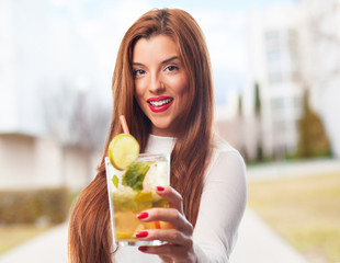 elegant woman drinking a mojito