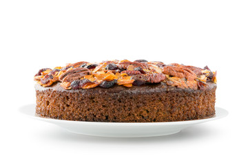 Pecan cake made with sliced almonds and dried cranberries isolated on white