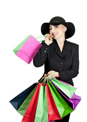 Happy lady in a business suit and hat with paper bags isolated on white background