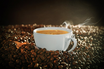 Cup of coffee and coffee beans closeup