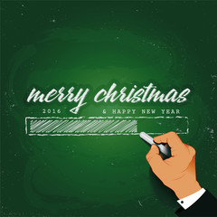 Merry Christmas Loading Hand writing with chalk on a blackboard
