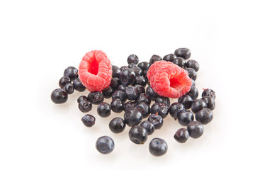 Beautiful raspberry and blueberries isolated on white