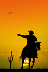 man on horseback at sunset