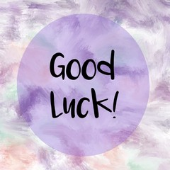 Good luck message written over purple painted background