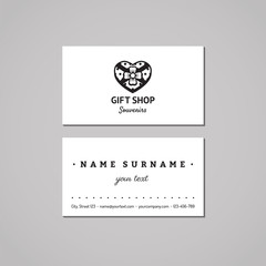 Gift shop and souvenirs business card design concept. Gift shop logo with heart box with bow. Vintage, hipster and retro style. Black and white.