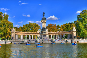 Beautiful HDR picture of tourists on boats at Monument to Alfonso XII in the Parque del Buen Retiro - Park of the Pleasant Retreat in Madrid, Spain