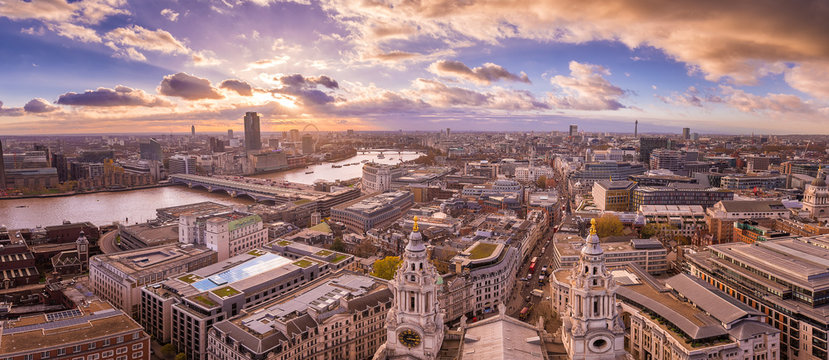 Panoramic skyline of London shot from the top of St. Paul's Cathedral with beautiful clouds at sunset.