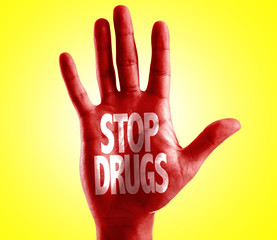 Stop Drugs written on hand with yellow background