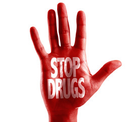 Stop Drugs written on hand isolated on white background