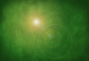 A green, grunge, stone texture, organic, earthy background with a sun flare.