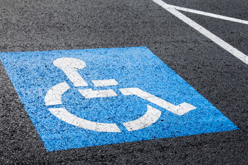 Handicapped parking spot symbol on asphalt