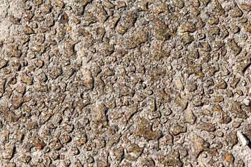 Water droplets on concrete due to oil contamination