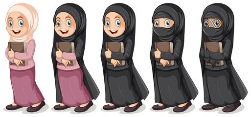 Muslim girl holding book