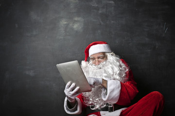 Santa Claus with a new device