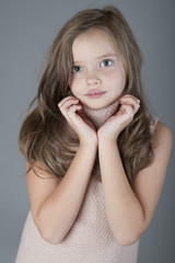 Portrait of little cute girl with long hair..