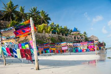 A fabrics market on a pristine beach in a tourist destination Wall mural
